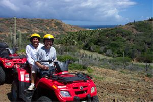 Cille and Rob going for an ATV ride in Aruba