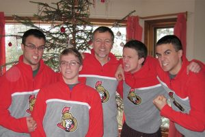 Rob Harris and the boys sporting their Sens Fans shirts