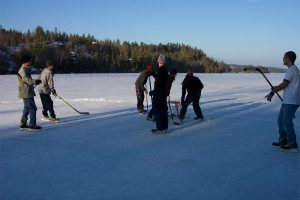 Rob Harris and sons playing ice hockey on the lake and Out Living the Dream